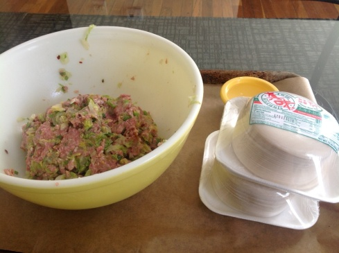 My vintage pyrex bowl of filling, some wrappers, and a little bowl of water to seal them up.